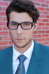 Close up portrait of young elegant handsome man in glasses
