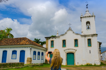 PARATY, RIO DE JANEIRO, BRAZIL - JAN 17, 2016: blonde tourist ph