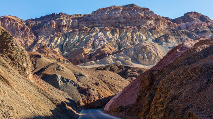 Artist drive turns into a narrow and winding road. Dry and hot, the drive is Located in Death Valley. Artist's Drive, Death Valley National Park