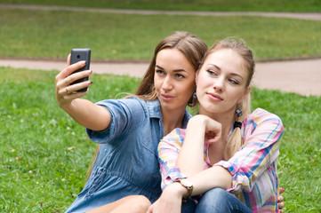 two women friends doing selfie phone