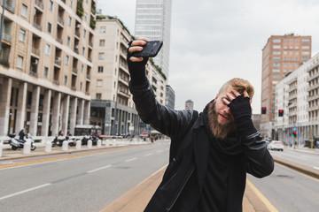 Stylish bearded man taking a selfie