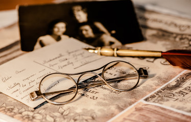 Old letter, eyeglasses and photo.
