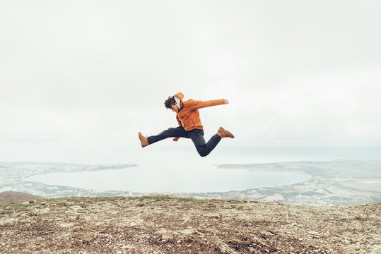 Happy guy jumping outdoor