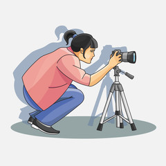 Young female photographer photographing