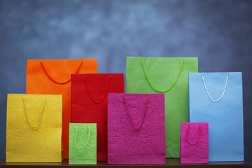 Coloured shopping bags on grey background