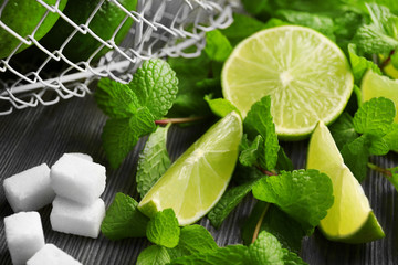 Slices of lime, mint and sugar, closeup