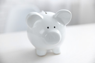 Savings concept. Piggy bank on white table, close up