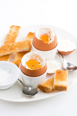 boiled eggs and crispy toast for breakfast, vertical