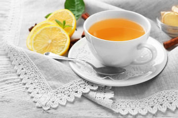 Cup of tea with ginger on napkin