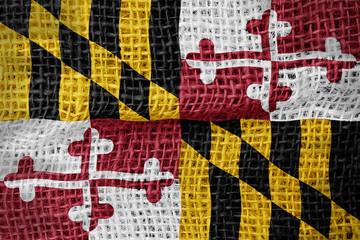 Maryland flag on sackcloth textured background
