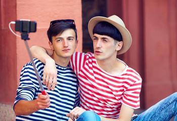 male couple making selfie on smart phone