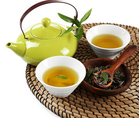 Green tea with utensils, isolated on white