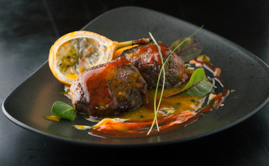 Delicious beef medallions with papaya and Granadilla sauce on a
