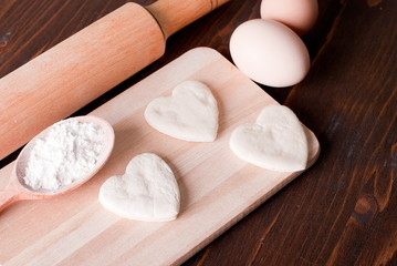 dough in the form of hearts on a cutting board