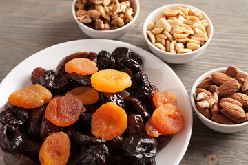 Dried fruits in a white plate with nuts