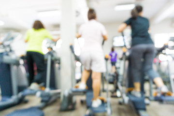 Fitness equipment with people at gym room