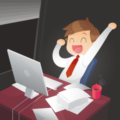 Young successful businessman in the office at night
