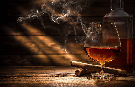 Whiskey with smoking cigar