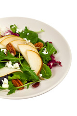 Pear Salad with Goat Cheese. Isolated on white. Selective focus.