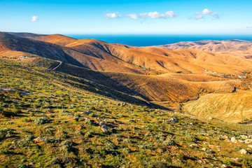 Aerial view on Fuerteventura island from Morro Velosa viewpoint with beautiful soft mointains landscape