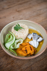 Thai healthy food brown rice with pumpkin soup.