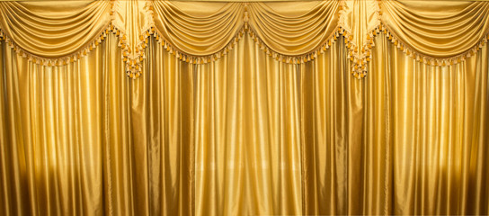 Gold curtains on stage