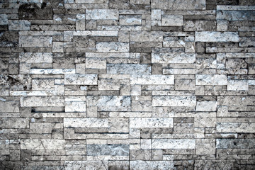 Cool brick grunge texture wall background. Haunt and horror. Rough and mess. Dark vignette. Close up.