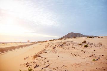 Desert road on Corralejo dunes on Fuerteventura island in Spain