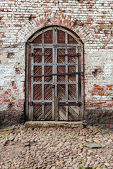 Old wooden gate at the medieval castle in Vyborg, Russia