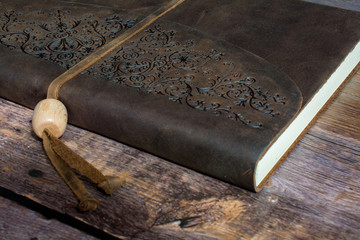 Classic Leather Bound Journal Book on a Old Barn Board Floor Close Up