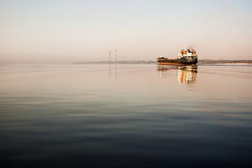 cargo ship floats on the river Volga