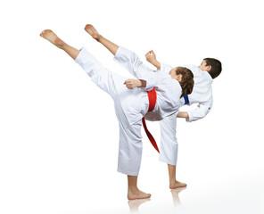 Man and woman performing a high kick