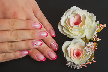 Red french nail art with flower