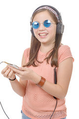preteen girl listening to music with his smartphone, on white