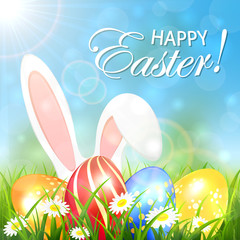 Spring background with colored Easter eggs and rabbit