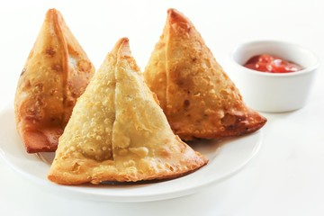 Samosas Indian snack food on white background