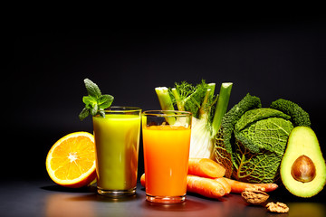 Glasses with fresh vegetable juices isolated on Black. Detox diet.