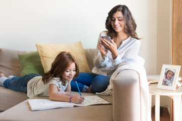 Girl painting with her mom chating