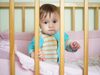 Little baby in a cot.