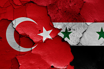 flags of Turkey and Syria painted on cracked wall