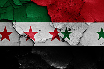 flags of Free Syrian Army and Syria painted on cracked wall