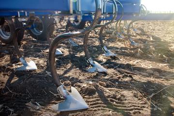 Plow on field in spring