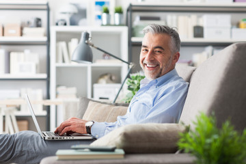 Cheerful businessman working at home