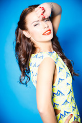 portrait of beautiful brunette young lady on blue background isolated. fashion style