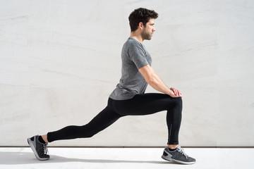 Man stretching quadriceps