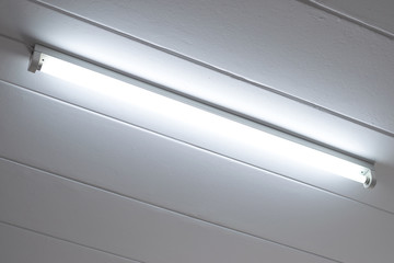 Fluorescent light bulb in the room.