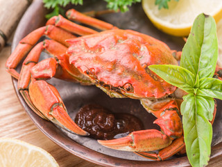 Cooked crab with lemon and herbs.