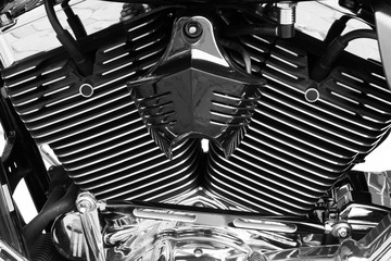 Motorbike's chromed engine black and white background