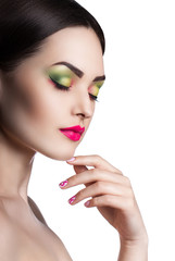 fashion portrait of a young beautiful girl with bright makeup.
