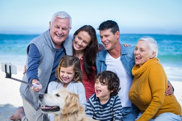 Happy family with their dog taking a selfie